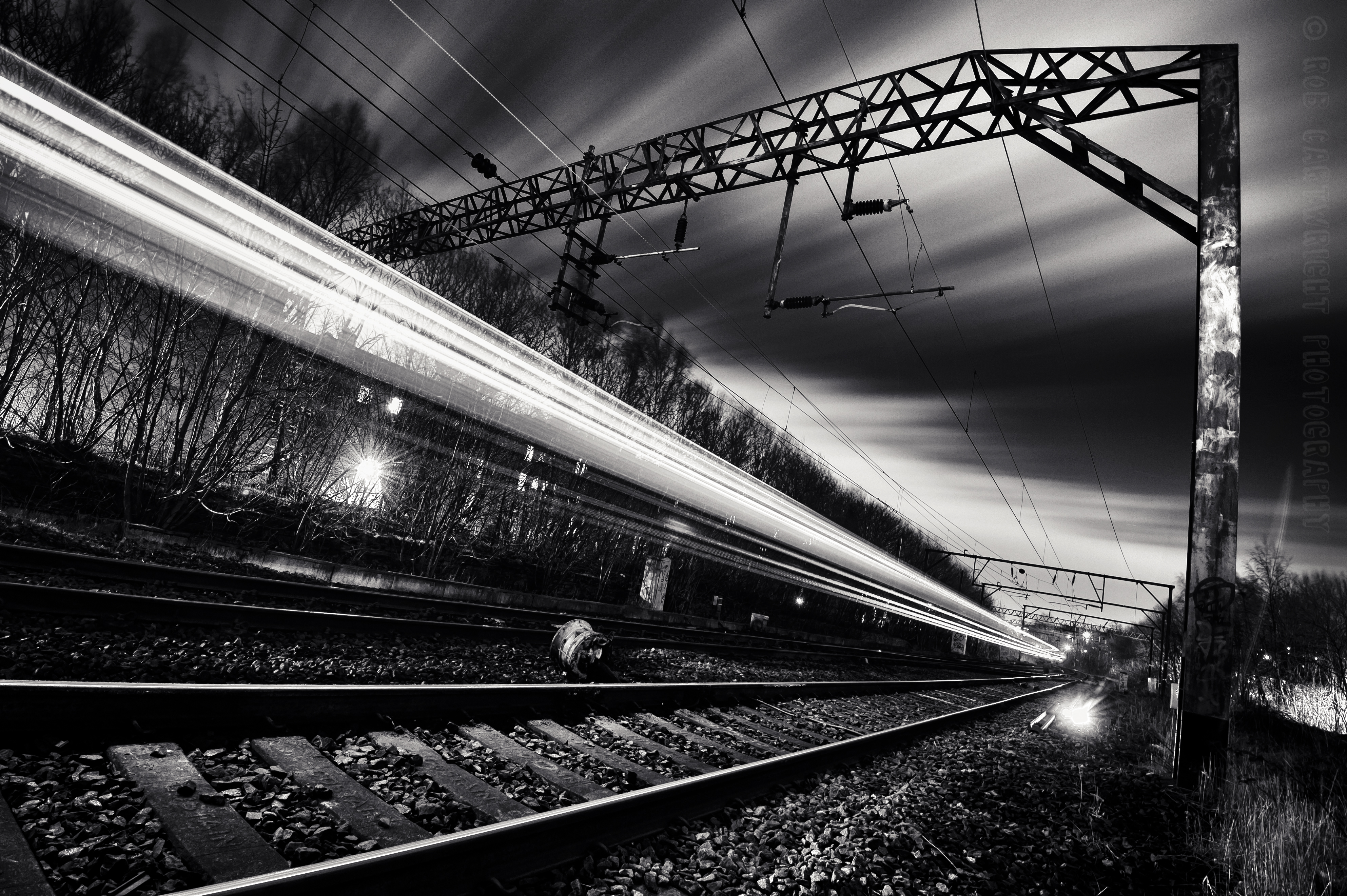 rail-line-in-glasgow-at-night-with-light-trails-wide-angle-black-and-white[1]